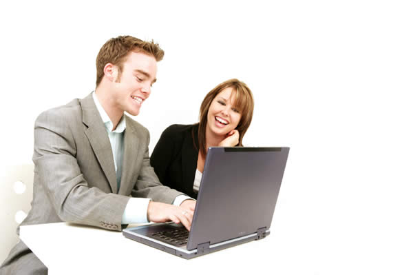 Adults contributing at laptop
